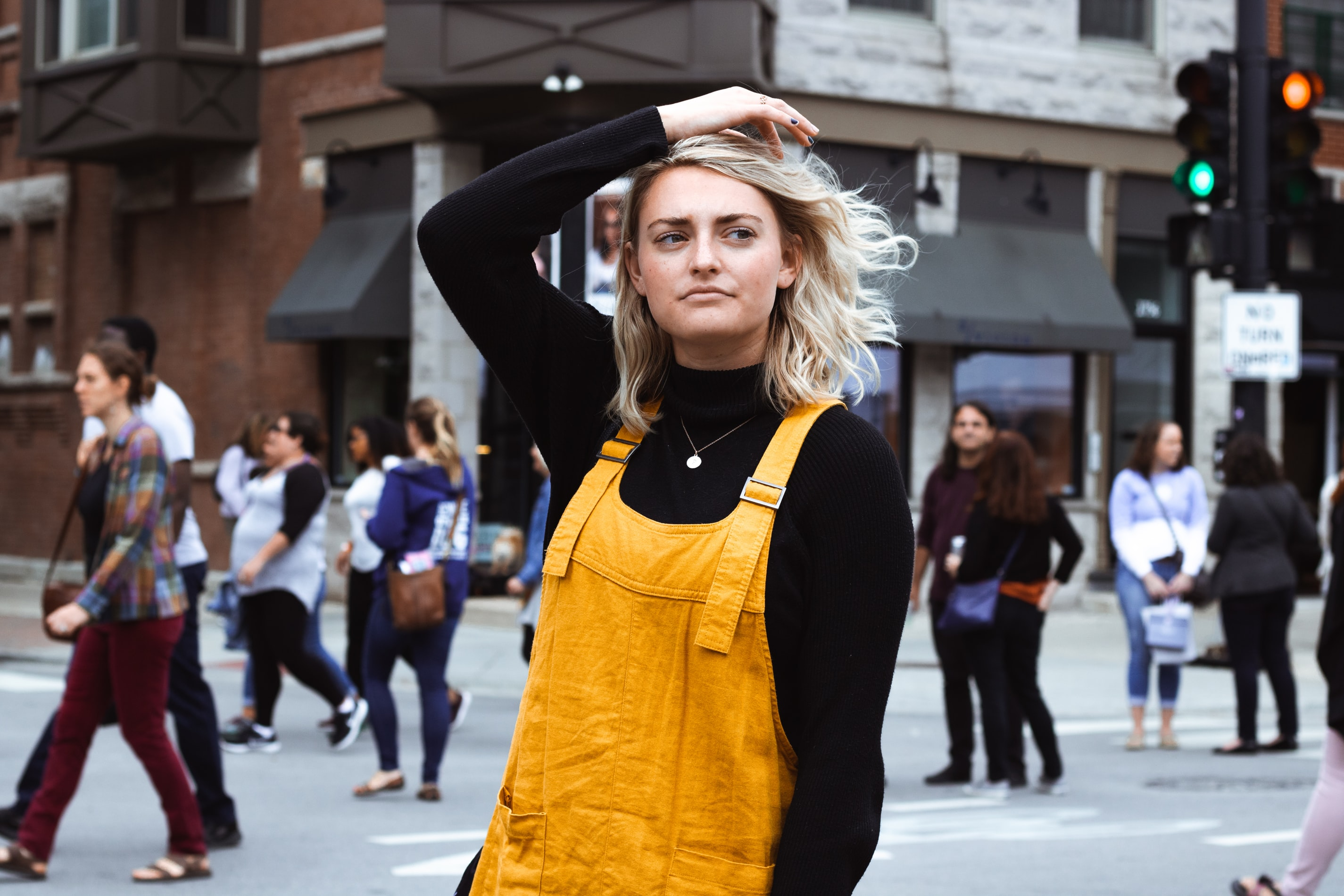 girl in yellow overalls